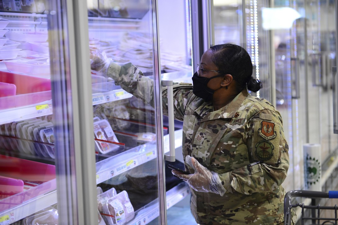 U.S. Air Force Tech. Sgt. Kahlia Rainer, volunteer, retrieves ground turkey at the commissary on Aviano Air Base, Italy, April 18, 2020. Rainer is one of more than 170 volunteers who stepped up to assist those in need by delivering groceries during the battle against COVID-19. (U.S. Air Force photo by Tech. Sgt. Tory Cusimano)